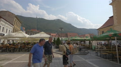 Beautiful forest on Tampa hill and outdoor restaurants in Council Square, Brasov Stock Footage