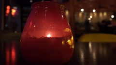 4k Candle in busy bar, close up with background out of focus bokeh lights Stock Footage