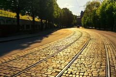 Stock Photo of Bending tram rails on the pavement of the street