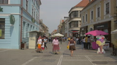Gypsies buying ice cream on Republicii street, Brasov Stock Footage