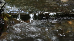 Water running of stream Ehrbach next to Mosel River. Stock Footage