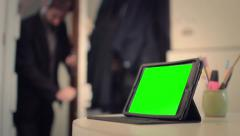 Man arrives at office to work on tablet - Green Screen - 1080p Stock Footage