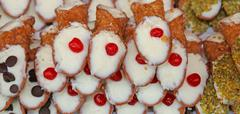 typical Sicilian pastries called CANNOLI with pastry cream for sale in pastry - stock photo