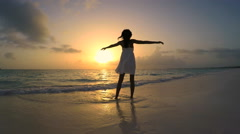 African American girl in white clothes enjoying tropical beach sunrise Stock Footage