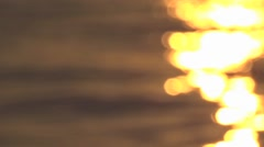 Blurry Golden sunlight path reflection Stock Footage