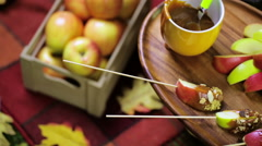 Autumn picnic with fresh caramel apple slices. Stock Footage