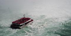Tourist boats exploring Niagara Falls - Natural wonder of the world Stock Footage