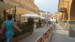 Walking in front of Paralela 45 travel agency, near the Council Square, Brasov Stock Footage