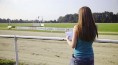 Viewer of harness race marking bulletin 4K Stock Footage
