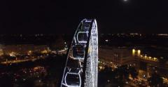 Budapest eye – the  Giant Ferris Wheel in the moon light. (Aerial). 4K Stock Footage