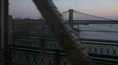 Slow motion Brooklyn bridge and Manhatten from new york subway Stock Footage