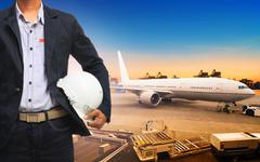 profesional working man in freight ,cargo air shipping and import export tran - stock photo