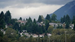 Houses On Slope Near Misty Mountains Stock Footage