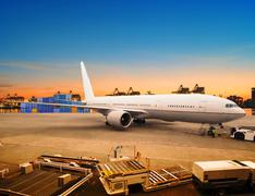 air freight and cargo plane loading trading goods in airport container parkin - stock photo