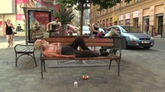 Authentic emotion homeless man asleep on a bench Stock Footage