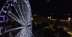 Budapest eye – the  Giant Ferris Wheel in the moon light. (Aerial) Stock Footage