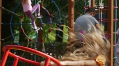 Girl is Swinging on a Swing With Her Toy Rabbit Pink Tilda Swinging on a Swing Stock Footage