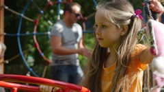 Girl is Swaying with Her Toy Rabbit Pink Tilda Swinging on a Swing Little Girl Stock Footage