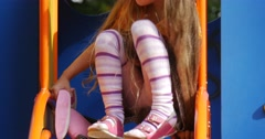 Girl is Sitting on The Chute With Pink Toy Tilda Rabbit Girl is Going Down Stock Footage