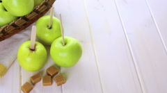 Apples ready to deeped in fresh caramel. - stock footage