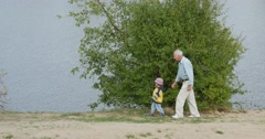 People Senior Aged Man And Child in Yellow Clothes Middle Aged and Senior Men Stock Footage