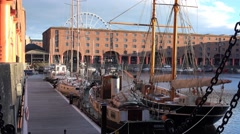 4k Albert docks in Liverpool, with reflection of buildings in water and boats Stock Footage