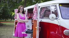 Stock Video Footage of Attractive girl stand beside a camper van doors 4K