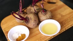 Beet, oil and spices on the board Stock Footage
