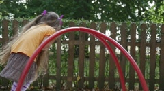 Girl is Swinging on The Carousel Slow Motion Little Girl With Long Fair Hairs Stock Footage