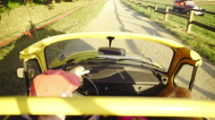 Driving yellow retro cabriolet beetle at sunset 4K Stock Footage