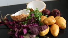 ingredients for stew: beets, potatoes, greens, coconut - stock footage