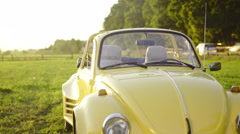 Old beetle side view with sun reflecting jib shot 4K Stock Footage