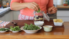 How To Pack the Perfect Salad vegetable Bulgur  in a Jar Stock Footage