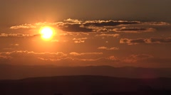 4K Amazing sunset sunrise sun silhouette mountain hill orange light romantic day Stock Footage