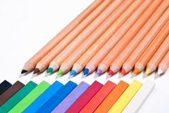 View of different color pencils and chalk pastels isolated on the white backg - stock photo
