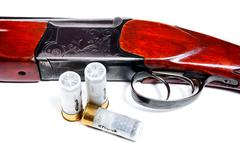 Hunting shotgun and ammunition on white background. Kuvituskuvat