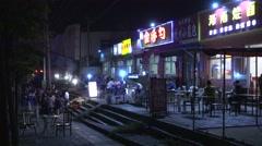 BBQ,night restaurants,neon,nightlife in Beijing,China,4K,25fps Stock Footage