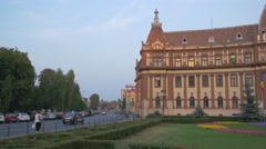Driving cars near the Central administration building of Brasov county, Brasov Stock Footage