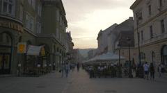 Walking on Republicii street at sunset, Brasov Stock Footage