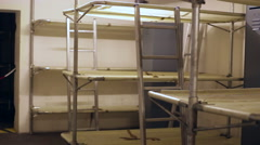 Bunk beds for soldiers inside a bunker Stock Footage