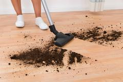 Close-up Of Person With Vacuum Cleaner Cleaning Dirt On Floor Stock Photos