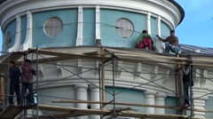 Men working construction on the scaffold - stock footage