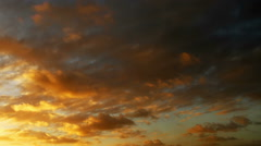 Cloudy sunset. 2 in 1. Blue sky with orange and gray clouds passing by. - stock footage
