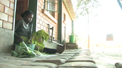 Stock Video Footage of Girl cutting cabbage in village in Kitwe, Zambia