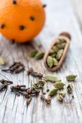 Spices and orange with clove buds. - stock photo