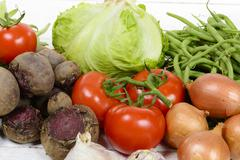 Seasons assorted vegetables with beets, tomatoes and beans Stock Photos