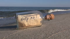 Bottle with a message on the ocean beach Stock Footage