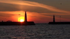 Two lighthouses in the port during sunrise Stock Footage