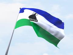 Lesotho flag flying on clear sky. - stock illustration
