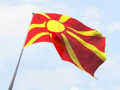 Stock Illustration of Macedonia flag flying on clear sky.
